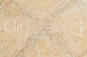 Old beige stone floor tiles with mosaic effect