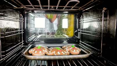 Baking Gingerbread man in the oven, view from the inside of the oven. Cooking in the oven.