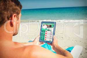 Composite image of man using digital tablet on deck chair at the