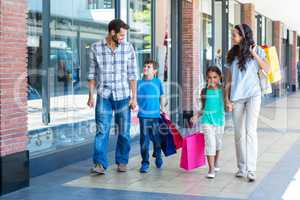 Happy family having fun in the mall