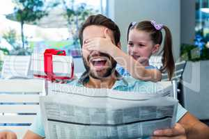 Daughter offering her present to her dad