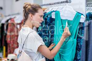 Shocked woman looking at price tag