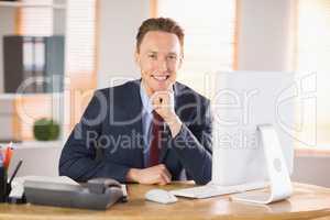 Stylish businessman smiling at camera