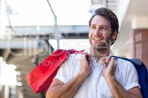 A happy smiling man with shopping bags