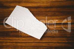 Scrap of paper on wooden table
