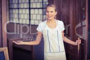 Smiling blonde waitress welcoming