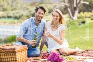 Cute couple on date pouring wine in a glass
