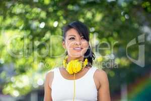 Athletic woman wearing yellow headphones
