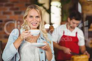 Pretty woman enjoying a cup of coffee