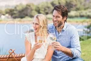 Couple on date toasting with glass of white wine