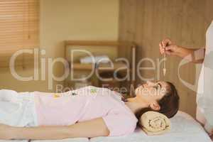 Young woman at crystal healing session