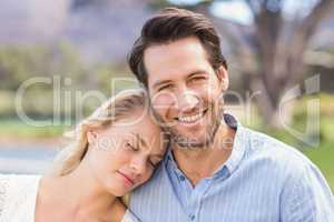 Smiling couple on date relaxing with eye closed