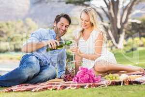 Cute couple on date holding glasses of wine