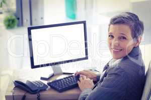 Smiling businesswoman using computer