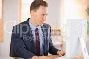 Stylish businessman working at his desk