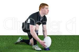 Rugby player ready to make a drop kick