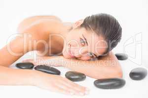 Pretty woman enjoying lying nearby hot stones