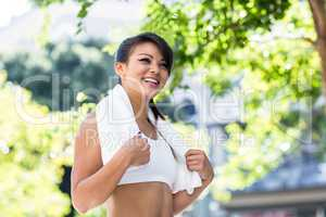 Smiling athletic woman with towel