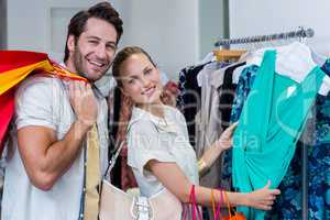Smiling couple browsing clothes