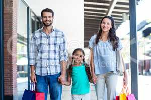 Portrait of a happy family with shopping bags