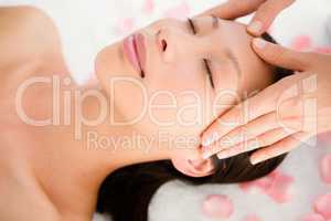 Attractive young woman receiving facial massage