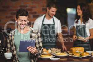 Smiling customer looking at tablet
