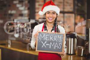 Pretty waitress with a chalkboard merry x-mas