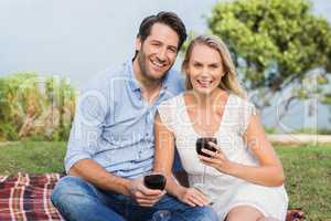 Cute couple on date holding red wine glasses