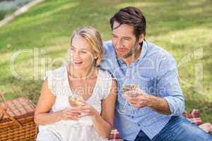 Couple on date holding a glass of white wine