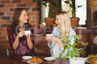 Female friends having coffee at coffee shop
