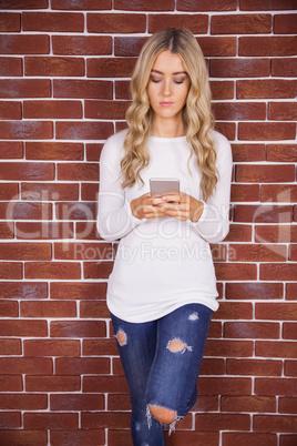 Stylish blonde woman using smartphone
