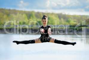 Young Gymnast is Up in the Air Doing Leg-Split