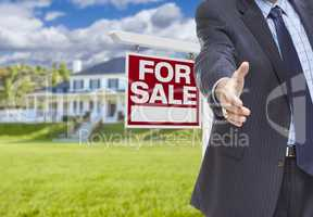 Agent Reaches for Handshake, Sale Sign and House Behind