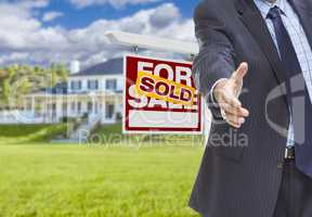 Agent Reaches for Handshake, Sold Sign and House Behind