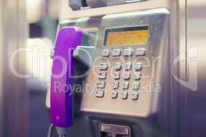 pinkfarbener Telefonhörer