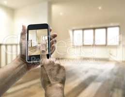 Smarthphone with man hand taking picture in modern loft studio