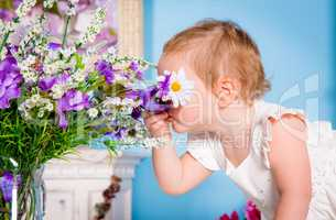 Little girl and flower