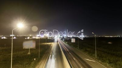 Speed Traffic at Sundown Time - light trails on motorway highway at night