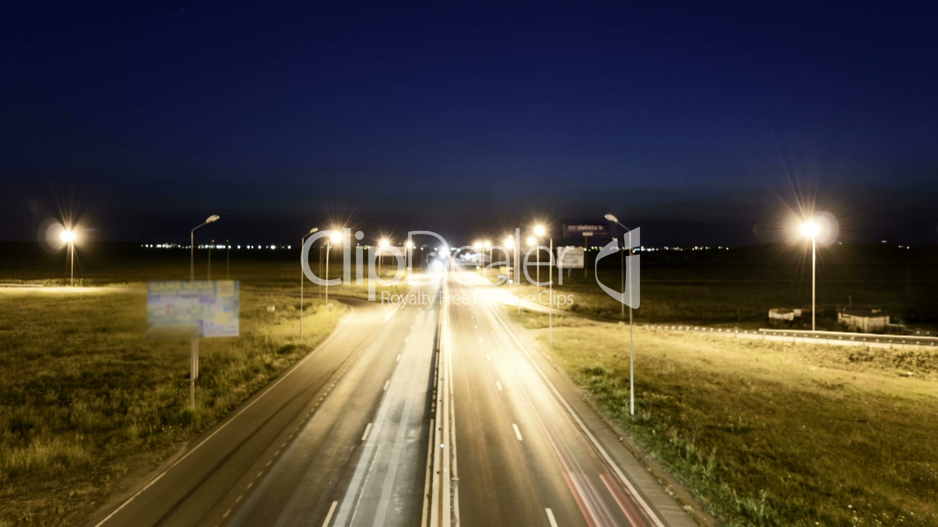 Speed Traffic at Sundown Time - light trails on motorway highway at