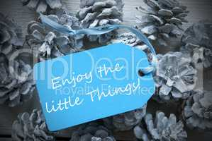 Light Blue Label On Fir Cones Quote Enjoy Little Things
