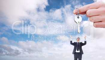 Composite image of focus shot on a woman holding a key