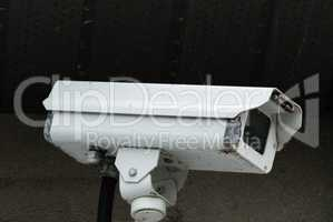 Old white surveillance camera
