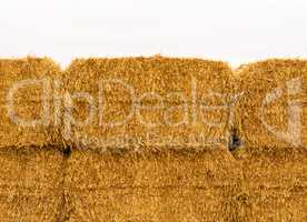 Close-up of yellow stacked hay bales