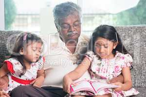 Family reading story book together