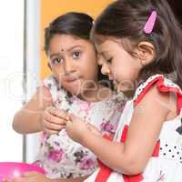 Sibling sharing snacks