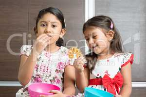 Sibling eating snacks
