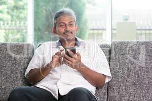 Indian guy using smartphone