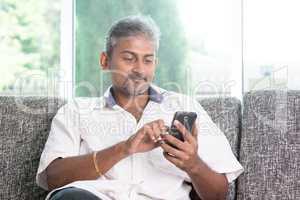 Indian man using smartphone