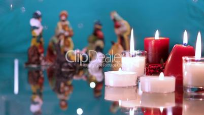 Christmas nativity scene with candles on green