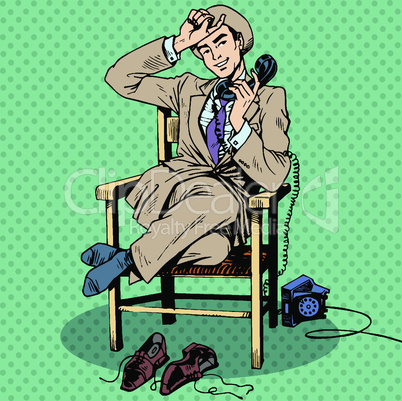 Tired man sits on a chair and talking on the phone